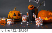 Купить «pumpkins, candies and halloween decorations», видеоролик № 32429669, снято 14 ноября 2019 г. (c) Syda Productions / Фотобанк Лори