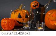 Купить «pumpkins, candles and halloween decorations», видеоролик № 32429673, снято 14 ноября 2019 г. (c) Syda Productions / Фотобанк Лори