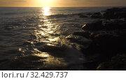 Купить «Каспийское море на закате. Волны набегают на скалистый берег. Caspian Sea at sunset. Waves run onto a rocky shore.», видеоролик № 32429737, снято 7 февраля 2019 г. (c) Евгений Романов / Фотобанк Лори