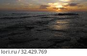 Купить «Каспийское море на закате. Волны набегают на скалистый берег. Caspian Sea at sunset. Waves run onto a rocky shore.», видеоролик № 32429769, снято 7 февраля 2019 г. (c) Евгений Романов / Фотобанк Лори
