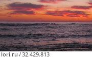 Купить «Каспийское море на закате. Волны набегают на скалистый берег. Caspian Sea at sunset. Waves run onto a rocky shore.», видеоролик № 32429813, снято 7 февраля 2019 г. (c) Евгений Романов / Фотобанк Лори