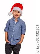 Kleiner Junge mit Nikolausmütze, Symbol für Weihnachten, Kindheit, Spaß, Cleverness. Стоковое фото, фотограф Zoonar.com/Erwin Wodicka / age Fotostock / Фотобанк Лори