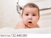 Baby boy head, infant looking at camera, lying in bed. Brown eyes with blond hair. Стоковое фото, фотограф Кекяляйнен Андрей / Фотобанк Лори