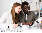Купить «Young woman and man colleagues working with laptop and papers», фото № 32440321, снято 18 февраля 2020 г. (c) Яков Филимонов / Фотобанк Лори