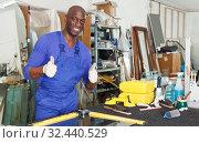 Купить «satisfied African-American workman in blue overalls», фото № 32440529, снято 16 мая 2018 г. (c) Яков Филимонов / Фотобанк Лори