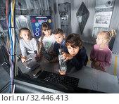 Купить «Children playing in bunker questroom», фото № 32446413, снято 21 октября 2017 г. (c) Яков Филимонов / Фотобанк Лори