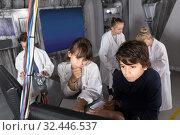 Купить «Children playing in bunker quest room», фото № 32446537, снято 21 октября 2017 г. (c) Яков Филимонов / Фотобанк Лори