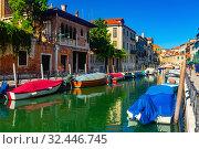 Купить «Venice cityscape with narrow canal», фото № 32446745, снято 5 сентября 2019 г. (c) Яков Филимонов / Фотобанк Лори