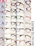Купить «Glasses showcase in modern optic shop», фото № 32446813, снято 27 августа 2019 г. (c) Яков Филимонов / Фотобанк Лори