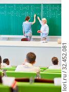 Купить «Dozentin und Studentin lösen an der Tafel eine mathematische Formel», фото № 32452081, снято 5 августа 2020 г. (c) age Fotostock / Фотобанк Лори