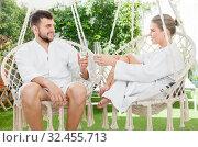 Купить «Couple enjoying vacation in spa resort outdoors», фото № 32455713, снято 24 апреля 2018 г. (c) Яков Филимонов / Фотобанк Лори
