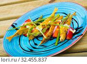 Купить «Sardines fried in batter with creamy ginger sauce on cushion of sweet tomatoes», фото № 32455837, снято 23 августа 2018 г. (c) Яков Филимонов / Фотобанк Лори