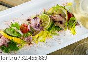 Купить «Boiled squid, mix salad and lime», фото № 32455889, снято 22 февраля 2020 г. (c) Яков Филимонов / Фотобанк Лори