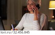 Купить «old woman calling on smartphone at home at night», видеоролик № 32456845, снято 18 ноября 2019 г. (c) Syda Productions / Фотобанк Лори