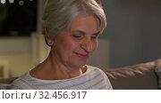 Купить «happy senior woman with tablet pc at home at night», видеоролик № 32456917, снято 18 ноября 2019 г. (c) Syda Productions / Фотобанк Лори