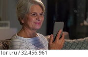 Купить «happy senior woman with smartphone at home», видеоролик № 32456961, снято 18 ноября 2019 г. (c) Syda Productions / Фотобанк Лори