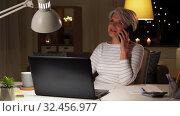 Купить «old woman calling on smartphone at home at night», видеоролик № 32456977, снято 18 ноября 2019 г. (c) Syda Productions / Фотобанк Лори