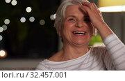 Купить «portrait of happy senior woman at home in evening», видеоролик № 32457001, снято 18 ноября 2019 г. (c) Syda Productions / Фотобанк Лори