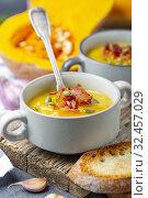 Купить «Pumpkin soup with crispy bacon close up», фото № 32457029, снято 22 сентября 2019 г. (c) Марина Сапрунова / Фотобанк Лори
