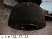 Купить «Sand on slicks tires on racing cars in garage», фото № 32457133, снято 22 мая 2019 г. (c) Aleksejs Bergmanis / Фотобанк Лори