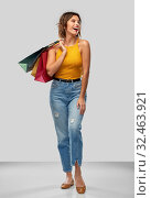 Купить «happy smiling young woman with shopping bags», фото № 32463921, снято 30 сентября 2019 г. (c) Syda Productions / Фотобанк Лори