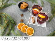 Купить «mulled wine, orange slices, gingerbread and spices», фото № 32463993, снято 4 октября 2018 г. (c) Syda Productions / Фотобанк Лори