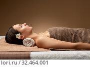 Купить «young woman lying at spa or massage parlor», фото № 32464001, снято 13 октября 2019 г. (c) Syda Productions / Фотобанк Лори