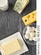 Купить «different kinds of cheese, milk glass and butter», фото № 32464033, снято 16 августа 2018 г. (c) Syda Productions / Фотобанк Лори
