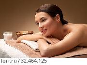 Купить «young woman lying at spa or massage parlor», фото № 32464125, снято 13 октября 2019 г. (c) Syda Productions / Фотобанк Лори