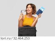 Купить «happy young woman with air ticket and travel bag», фото № 32464253, снято 30 сентября 2019 г. (c) Syda Productions / Фотобанк Лори