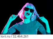 Купить «happy woman in pink wig and sunglasses dancing», фото № 32464261, снято 30 сентября 2019 г. (c) Syda Productions / Фотобанк Лори
