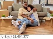 Купить «happy couple with boxes moving to new home», фото № 32464377, снято 27 октября 2019 г. (c) Syda Productions / Фотобанк Лори