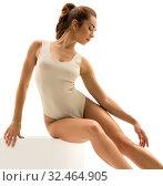 Купить «Photo of ballet dancer gracefully sitting on cube», фото № 32464905, снято 7 июля 2016 г. (c) Гурьянов Андрей / Фотобанк Лори