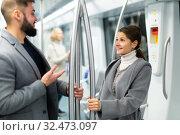 Happy passengers flirting in subway and smiling. Стоковое фото, фотограф Яков Филимонов / Фотобанк Лори