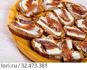 Купить «Pickled anchovy fillets on bread with butter», фото № 32473381, снято 10 апреля 2020 г. (c) Яков Филимонов / Фотобанк Лори