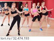 Купить «Happy smiling women are practising rouch movement in jazz dance», фото № 32474193, снято 31 мая 2017 г. (c) Яков Филимонов / Фотобанк Лори