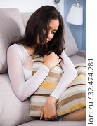 Купить «Gloomy teenager girl with pillow», фото № 32474281, снято 30 мая 2017 г. (c) Яков Филимонов / Фотобанк Лори