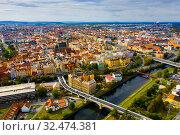 Купить «Picturesque aerial view of old buildings of Pilsen cityscape with river and ponds, Czech Republic», фото № 32474381, снято 11 октября 2019 г. (c) Яков Филимонов / Фотобанк Лори