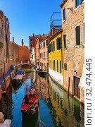 Купить «Gondola in canal of Venice», фото № 32474445, снято 5 сентября 2019 г. (c) Яков Филимонов / Фотобанк Лори