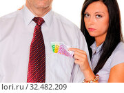Junge Frau zieht einem Mann Geld aus der Tasche. Euro. Стоковое фото, фотограф Zoonar.com/Erwin Wodicka / age Fotostock / Фотобанк Лори