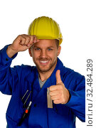 Ein Arbeiter in einem Gewerbebetrieb ( Handwerker ) mit Werkzeug in der Hand. Стоковое фото, фотограф Zoonar.com/Erwin Wodicka / age Fotostock / Фотобанк Лори