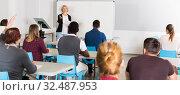Купить «Students with teacher studying in classroom», фото № 32487953, снято 8 мая 2018 г. (c) Яков Филимонов / Фотобанк Лори