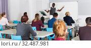 Купить «African American teacher giving presentation for students», фото № 32487981, снято 8 мая 2018 г. (c) Яков Филимонов / Фотобанк Лори