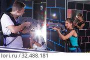 Купить «man and woman with laser guns», фото № 32488181, снято 27 августа 2018 г. (c) Яков Филимонов / Фотобанк Лори