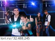 Купить «Team of laser tag winners guy and young woman and losers team i», фото № 32488245, снято 27 августа 2018 г. (c) Яков Филимонов / Фотобанк Лори