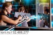 Купить «young people with plastic laser guns», фото № 32488277, снято 27 августа 2018 г. (c) Яков Филимонов / Фотобанк Лори