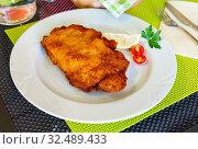 Купить «Tasty pork steak ljubljana stuffed with cheese and ham», фото № 32489433, снято 15 декабря 2019 г. (c) Яков Филимонов / Фотобанк Лори