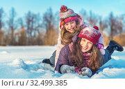 Купить «Active mother and daughter playing in winter park», фото № 32499385, снято 22 февраля 2018 г. (c) Sergey Borisov / Фотобанк Лори