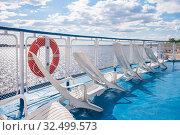 Купить «Sun loungers on the deck of a river cruise ship», фото № 32499573, снято 21 мая 2019 г. (c) Дмитрий Тищенко / Фотобанк Лори
