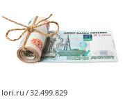 Купить «Билет банка России в 1000 рублей в рулоне из денег», фото № 32499829, снято 8 июня 2014 г. (c) Элина Гаревская / Фотобанк Лори